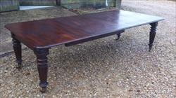 mahogany antique extending dining table.jpg