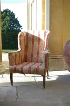 19th century Howard and Sons wing chair.jpg