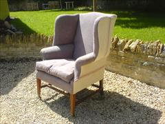 George III style wing chair made by Howard and Sons.jpg