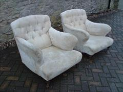 Antique armchairs by Howard and Sons of Berners Street in London.jpg