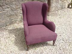 Antique low wing chair by Howard and Sons.jpg