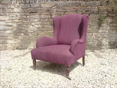 Antique low wing chair by Howard and Sons1.jpg