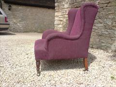 Antique low wing chair by Howard and Sons2.jpg