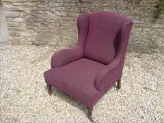 Antique low wing chair by Howard and Sons3.jpg