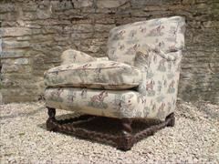 antique armchair made by Howard and Sons of London.jpg