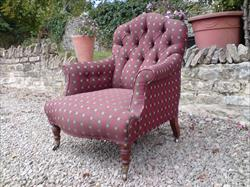 Howard and Sons button back antique armchair.jpg