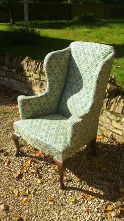 Howard and Sons antique wing chair.jpg
