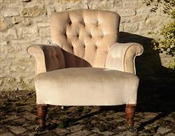 Howard and Sons button back antique antique armchair.jpg