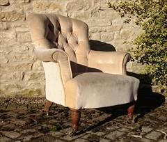 Howard and Sons button back antique antique armchair1.jpg